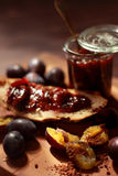 Plum jam in a transparent jar. Sweet Plum jam in a transparent jar Stock Photo