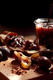 Plum jam in a transparent jar. Sweet Plum jam in a transparent jar Royalty Free Stock Photo