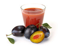 Plum juice and fruit Stock Photos