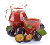 Plum juice and fruit Stock Images