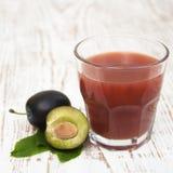 Plum juice Stock Images