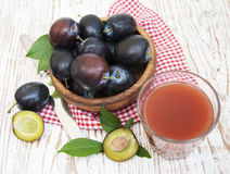 Plum juice Stock Images