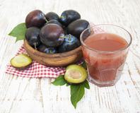 Plum juice Stock Photography