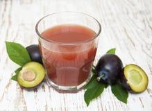 Plum juice Stock Photography