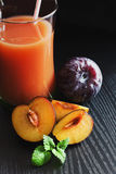 Plum juice in a glass Stock Photo