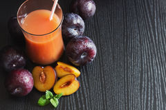 Plum juice in a glass Royalty Free Stock Images
