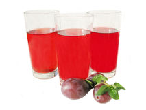 Plum juice in glasses Royalty Free Stock Image