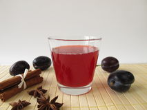 Plum juice with spices Royalty Free Stock Photo
