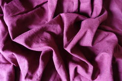 Plum linen fabric with folds and shadows. Plum colored linen fabric with folds and shadows Royalty Free Stock Image