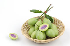 Plum Mango in basket Stock Photos