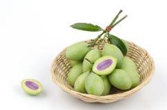 Plum Mango in basket Stock Photos