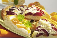 Plum and peach cake Stock Photography