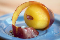 Plum while is peeled Royalty Free Stock Photos