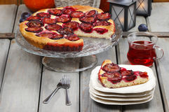 Plum pie in autumn party setting Stock Photos
