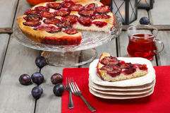 Plum pie in autumn party setting Royalty Free Stock Images