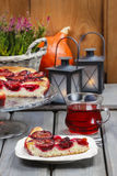 Plum pie in autumn party setting Royalty Free Stock Photography