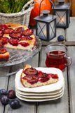 Plum pie in autumn party setting Royalty Free Stock Photo