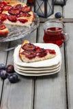 Plum pie in autumn party setting Stock Image