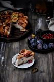 Plum pie, charlotte with plums in a cut royalty free stock photo