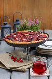 Plum pie on party table Royalty Free Stock Photos