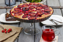 Plum pie on party table Royalty Free Stock Images