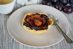 Plum Pie Right Out The Oven On A Withe Plate On A Wooden Table W royalty free stock image