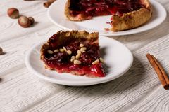 Plum pie on a white plate. Close up, horizontal royalty free stock images