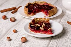 Plum pie on a white plate. Close up, horizontal royalty free stock image