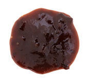 Plum preserves blob on a white background. Top view of blob of plum preserves spread on a white background royalty free stock images