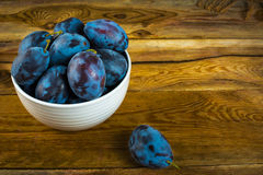 Plum prunes in a white cup Royalty Free Stock Photos