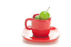 Plum in the red cup Stock Image
