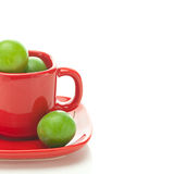 Plum in the red cup Stock Images