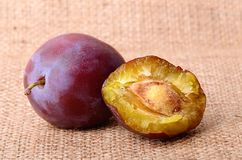 Plum on sackcloth Royalty Free Stock Photography