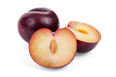 Plum. Sliced plum isolated on a white background Royalty Free Stock Image