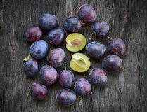 Plum on the table. Fresh ripe plum on a wooden background Stock Photo