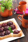 Plum tart. And cup of tea Royalty Free Stock Image