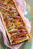 Plum tart with roasted marzipan Royalty Free Stock Image