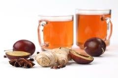 Plum tea with spices Stock Photo