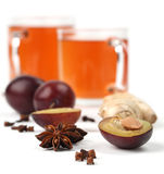 Plum tea with spices Royalty Free Stock Photos