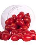 Plum tomatoes in glass Royalty Free Stock Photos