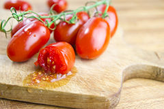 Plum tomatoes over cutting board Stock Image