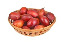 Plum in a wattled basket Stock Images