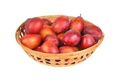 Plum in a wattled basket Royalty Free Stock Photos
