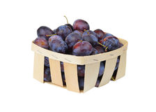 Plum in a wattled basket Stock Photos