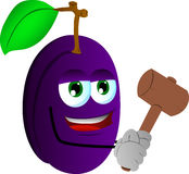 Plum with a wooden hammer Stock Photography