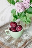 Plum on a wooden table– stock image Royalty Free Stock Images