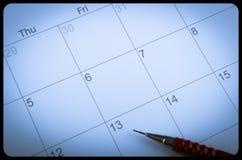 Pluma capítulo en el primer de la página del calendario Foto de archivo libre de regalías