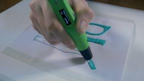 pluma 3D en trabajo Impresión con el filamento plástico del alambre Timelapse metrajes