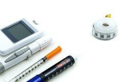 Pluma de la insulina, equipo y análisis de sangre llano de la glucosa, Di de la diabetes fotografía de archivo libre de regalías
