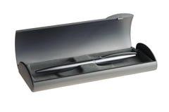 Pluma de plata en caja gris Imagen de archivo